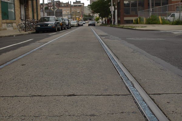 Getting a bike wheel caught in trolley tracks and wiping out is an unfortunate rite of passage for Philly cyclists. But on part of 11th Street, that's no longer a problem. Reader Rob Emanuele sent us this photo of some guerilla track-work in the area, noting,