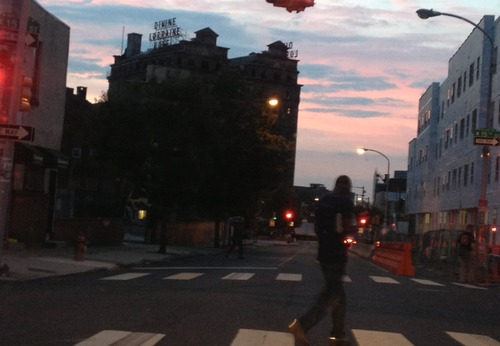Monday morning blues. Man walking to work, sunrise over the Divine Lorraine.
