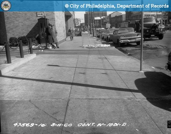 Cont. W-1001-D - Spring Garden Street-North Side - 13th Street to 12th Street: Sidewalk 1209-1215 Spring Garden Street East.