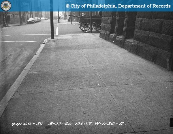 Contract #W-1120-D 13th Street - Buttonwood Street to Green Street: Sidewalk at School Showing Uneven Condition and Cracked Blocks 100 Feet to 125 Feet South of Brandywine Street.