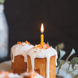 white and brown cake with candles
