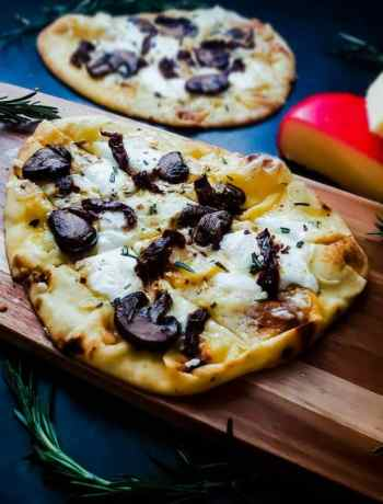 This vegetarian flatbread pizza recipe is healthy, easy and fast! The pizza works great as a dinner recipe or as an appetizer. This pizza has three types of cheese, an olive oil based sauce and mushrooms and fresh rosemary!