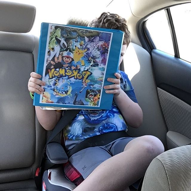 He won't go anywhere without his Pokemon binder with all of his cards.