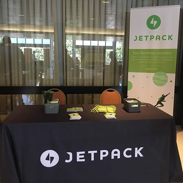 #jetpack booth is setup at #wcbos. Come see us for swag and to get any questions answered.