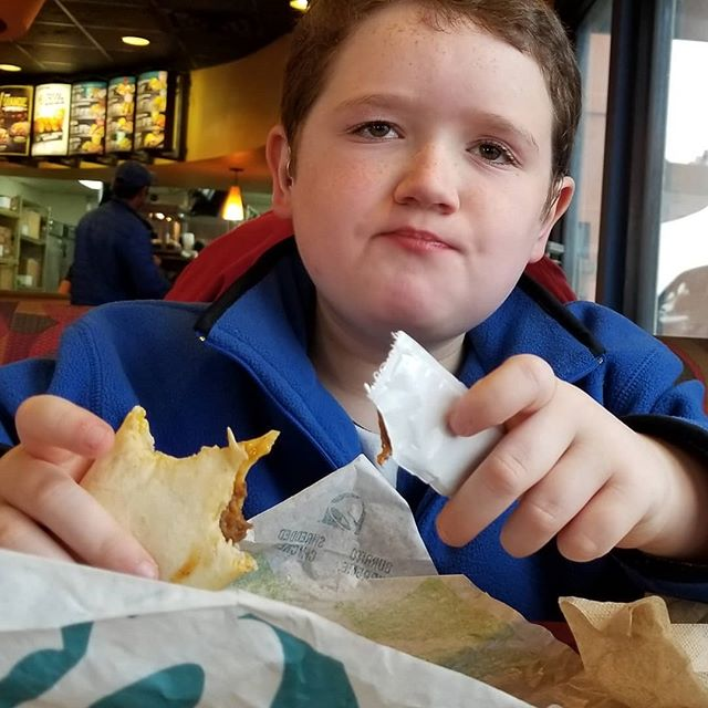 A boy with more Taco Bell