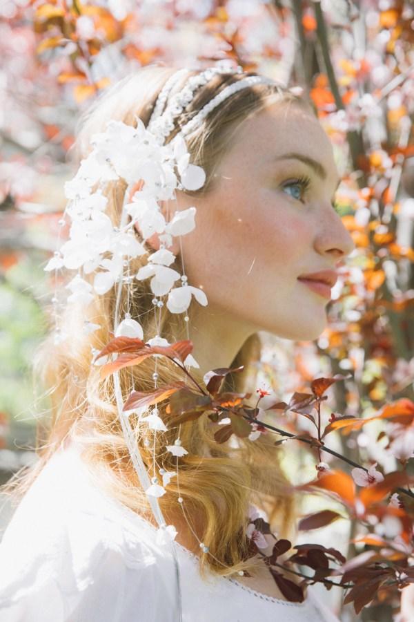 NAIDA BRAIDED HEADBAND WITH FALLING FLOWERS
