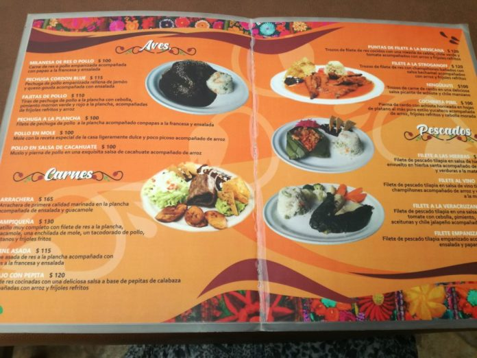 Image of a menu at a San Cristobal restaurant called El Sazon Que Me Toquen, shwoing cheap prices, lower cost of living in Mexico.
