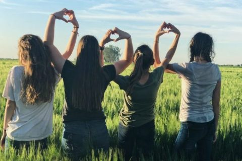 where have all the good men gone? Women stand together in a field.