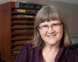 Linda Stolz | Owner, Erica Michaels Designs | Cross Stitch Patterns