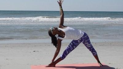 triangle pose on beach