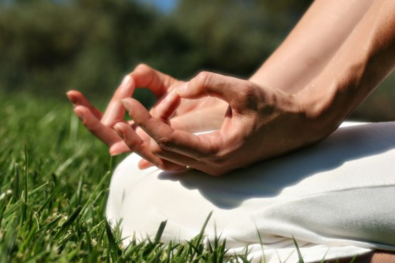 close up of hands during meditation