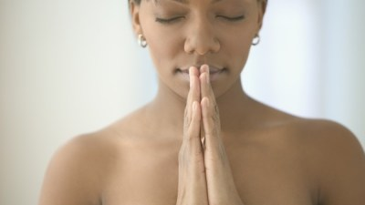 black woman meditating at home