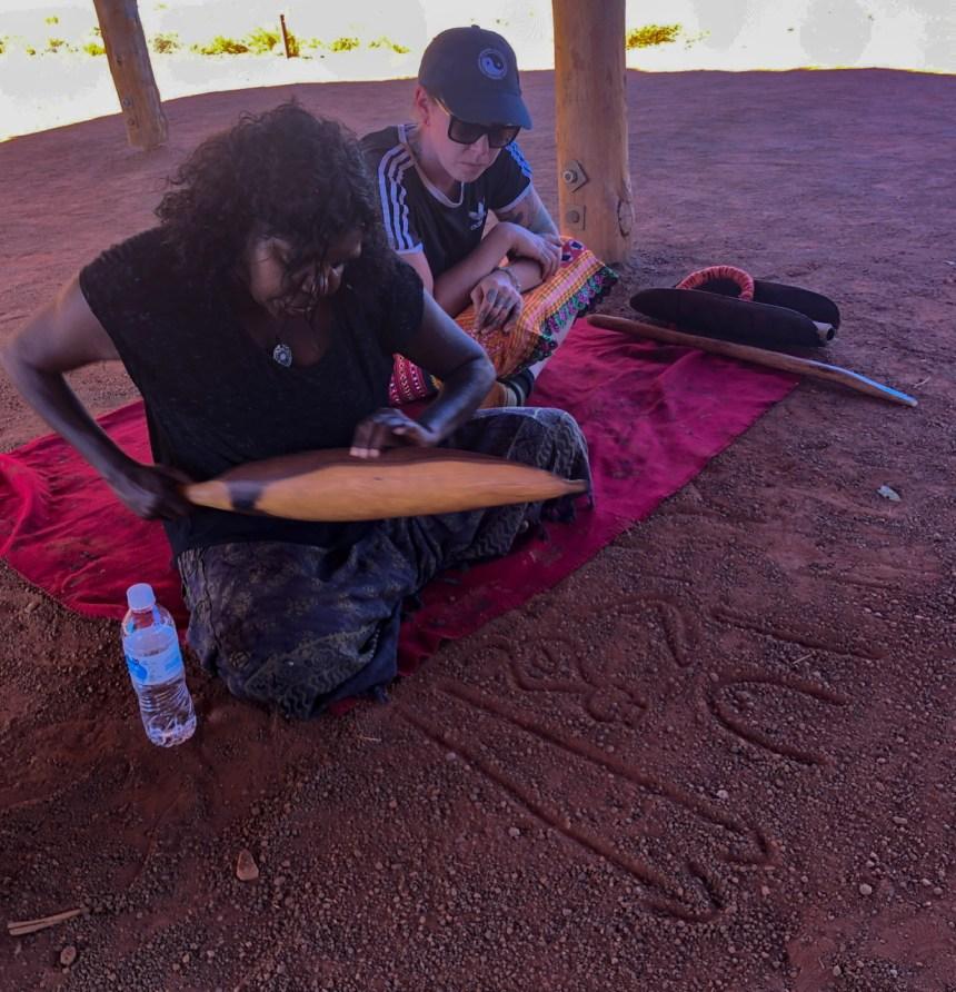 Uluru Anangu guide gives presentation near interpretive center