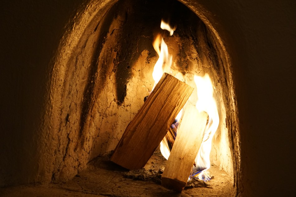 Fire in an adobe fireplace, Taos Inn, Taos, New Mexico, USA © 2018 ericarobbin.com | All rights reserved.
