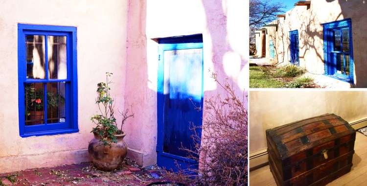 An art museum courtyard with vibrant blue door and window frame, planted rose pot, and antique chest Taos, New Mexico, USA © 2018 ericarobbin.com | All rights reserved.