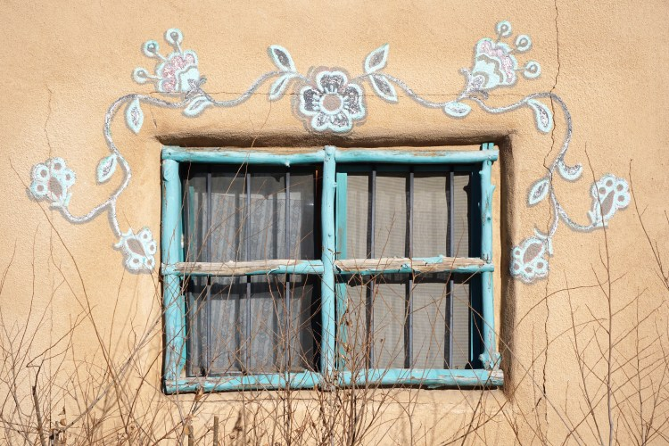 Flower painted window framing on adobe housing, Taos, New Mexico, USA © 2018 ericarobbin.com | All rights reserved.