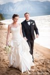 Birde & Groom stroll by boathouse South Lake Tahoe Valhalla Estate