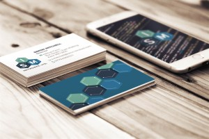modern and geometric logo design shown on business cards and iPhone for ISM Networks, LTD.