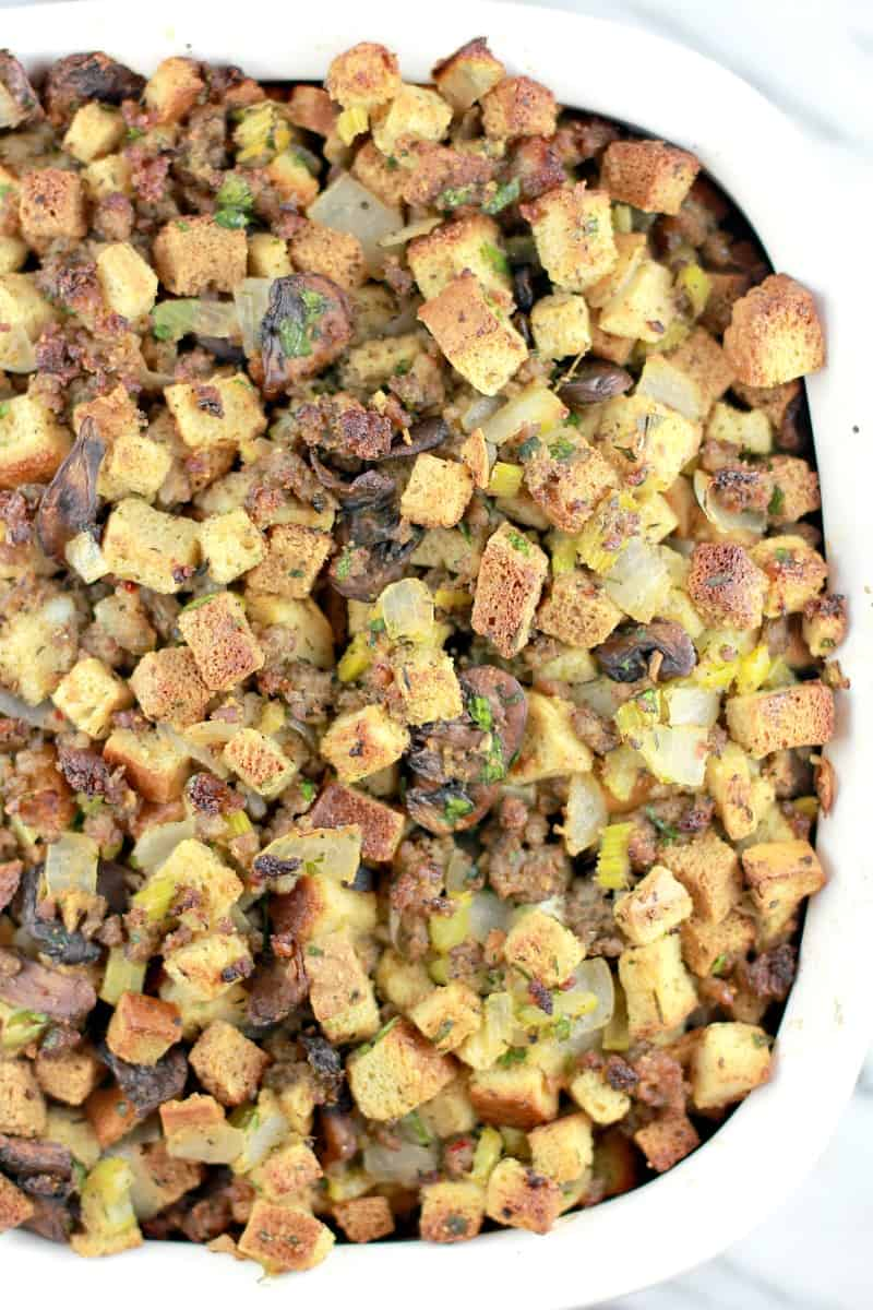 Top down view of the cooked homemade stuffing recipe, fresh from the oven showing the golden bread on top