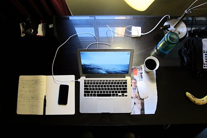 working-remote-hotel-room-desk-office