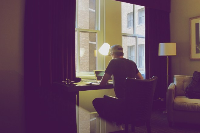 eric-dodds-working-remote-hotel-room-office