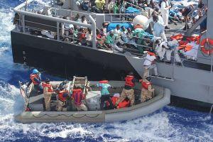 Modern refugees loading a boat....
