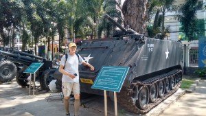 Me at the War Remnants Museum in Saigon. I'm standing in front of an armored personnel carrier in a courtyard crammed with American equipment.