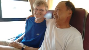 A former enemy and me enjoying a laugh at the back of the bus.