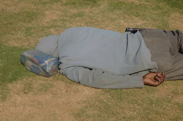 Man with bread pillow at The Golden Mile, South Africa