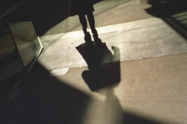 """Leaving"" - Santa Monica 3rd Street. Shot with my Contax IIIa film rangefinder. Gotta love the light and shadows."