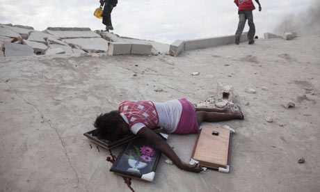 15-year-old lies dead after being shot in the head in Port-au-Prince. Photograph: Carlos Garcia Rawlins/Reuters