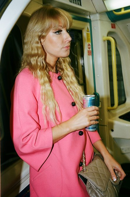 Woman in pink and Red Bull. London, 2011. Eric Kim