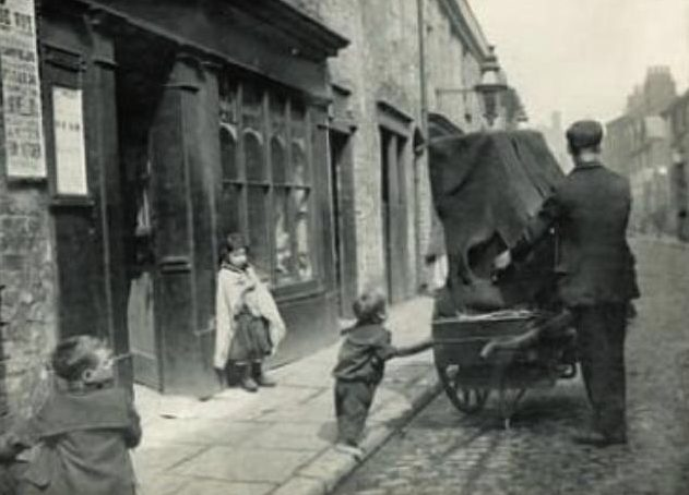 Organ Grinder and children. Photo by Samuel Coulthurst, c. 1894