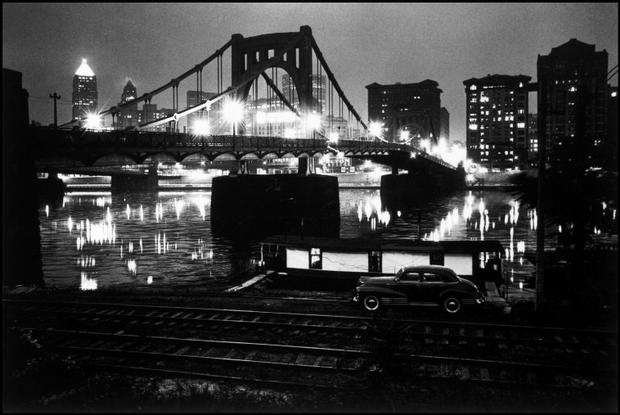 USA. Pennsylvania. City of Pittsburgh. 1955.  Skyline view at night, with the Delaware River. Copyright: Magnum Photos