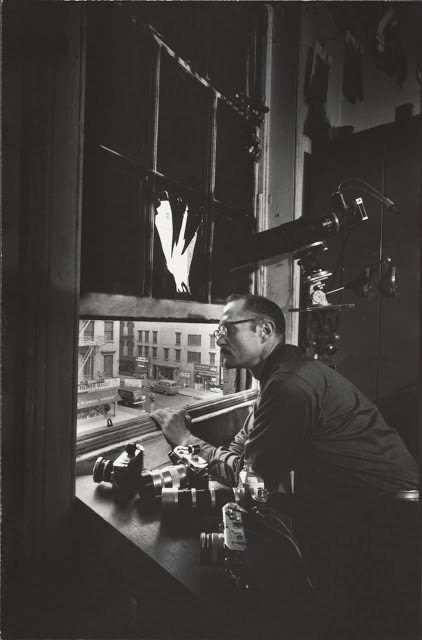 W. Eugene Smith looking outside of his window in Pittsburgh, 1957.