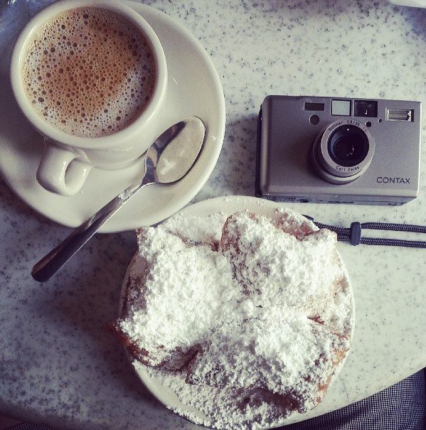 "Famous ""French"" beignet and coffee in New Orleans. I had a small (but delicious) heart attack after eating it. Thanks Kenneth!"