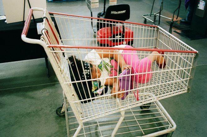 Costco, 2012. Girl in shopping cart.