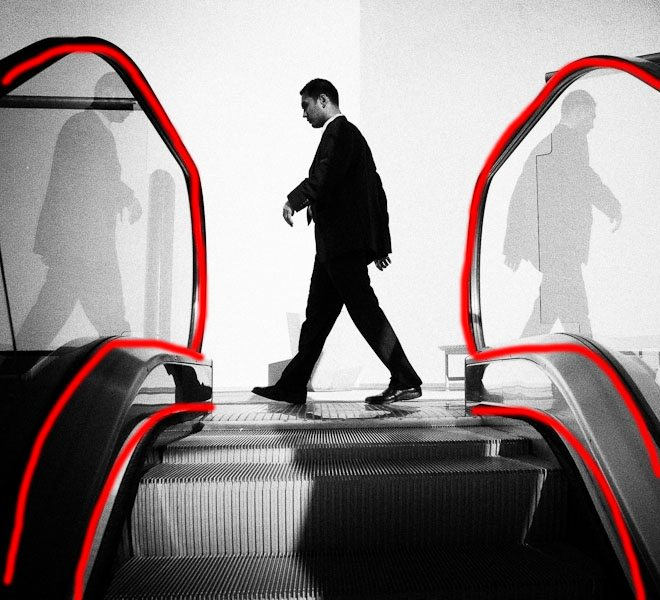 Figure 1: Note how the curving lines of the escalator frame the man.