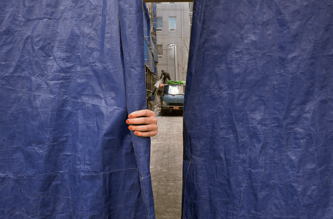 Photo by Trevor Marczylo. I love the juxtaposition between the blue of the tarp and the orange of the girl's fingernails.