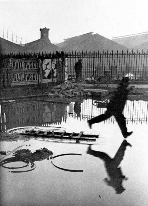 "Henri Cartier Bresson, 1932. The ""Decisive Moment"" of the man about to land in the puddle."
