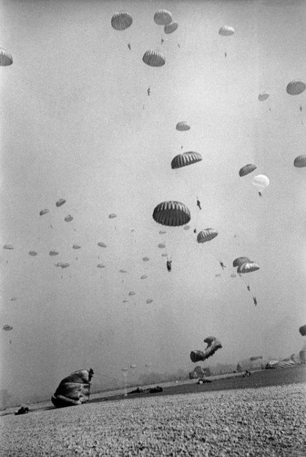 Robert Capa / Magnum Photos. GERMANY. Near Wesel. March 24th, 1945. American paratroopers landing in Germany.