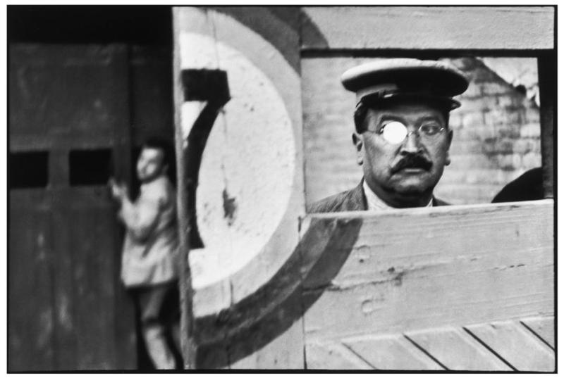 Copyright: Henri Cartier-Bresson / Magnum Photos /SPAIN. Valencia. 1933. Inside the sliding doors of the bullfight arena. Surreal because the right eye of the man is all white. As if he only had one eye.