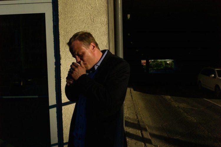 man lighting cigarette, Stockholm, Sweden, 2014