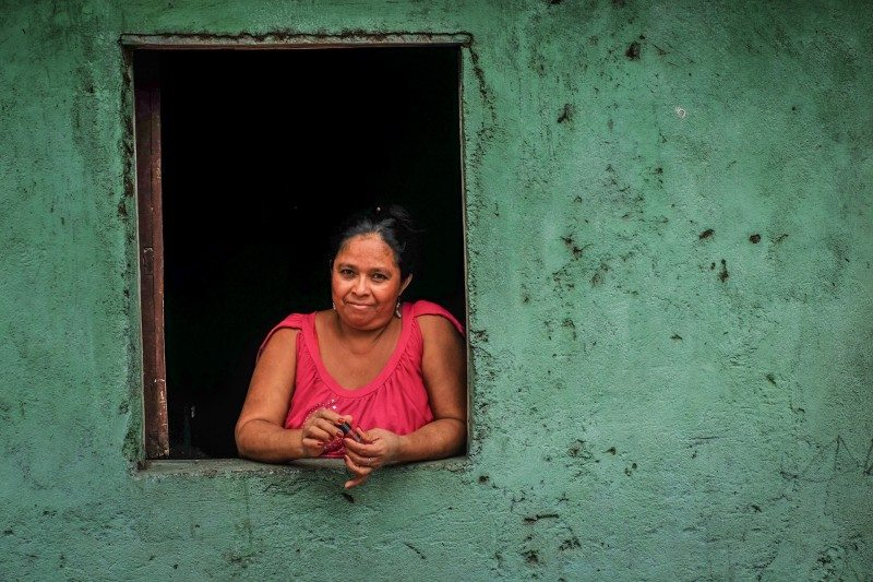 A woman hanging out in her window in Isla Ometepe, Nicauragua.