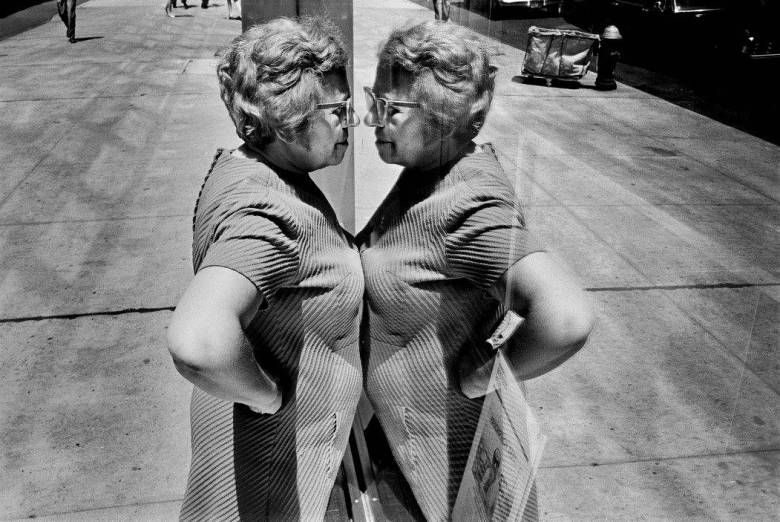 USA. New York City. 1969. Woman looking at herself in store window. (c) Richard Kalvar / Magnum Photos