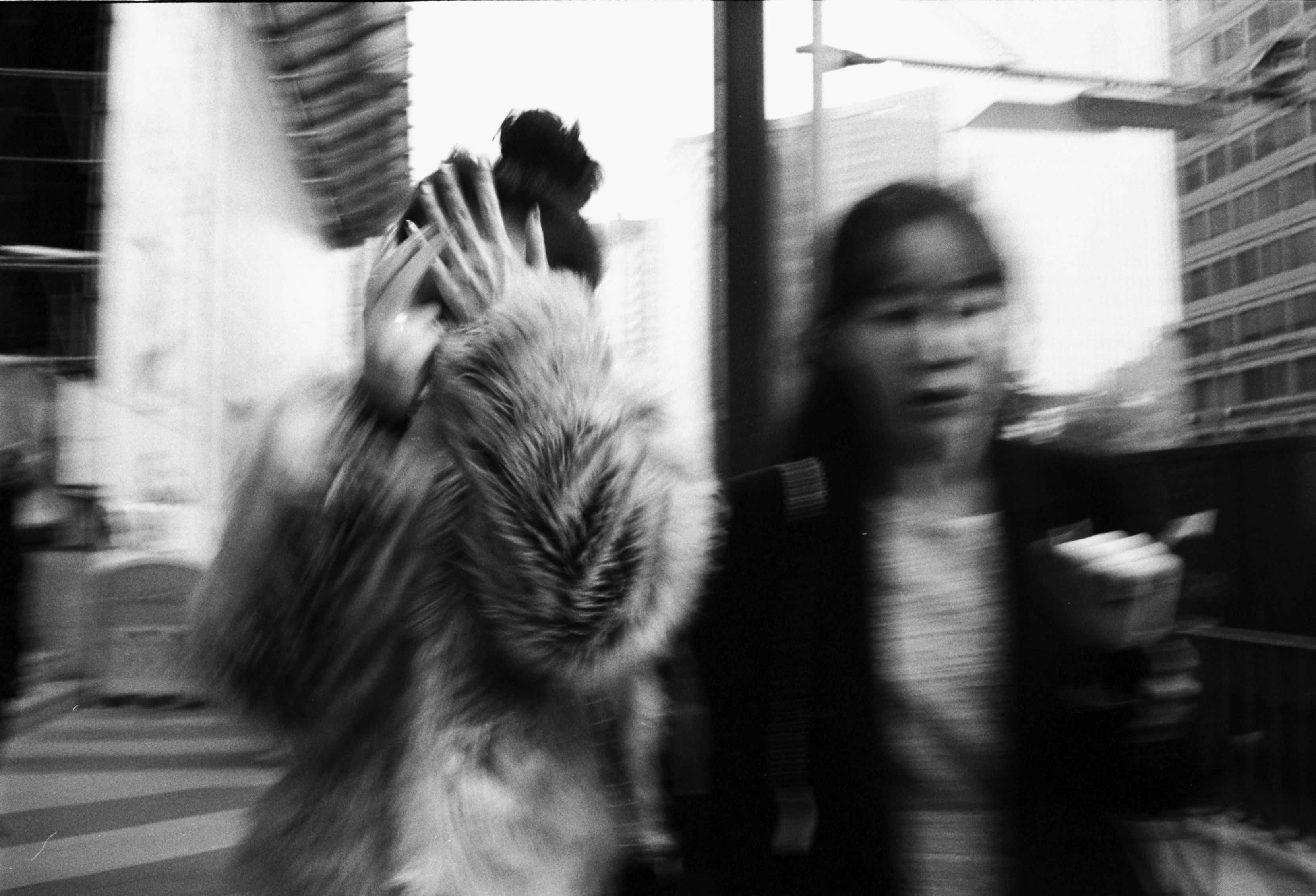 Seoul, 2012. Blur of woman in fur coat.