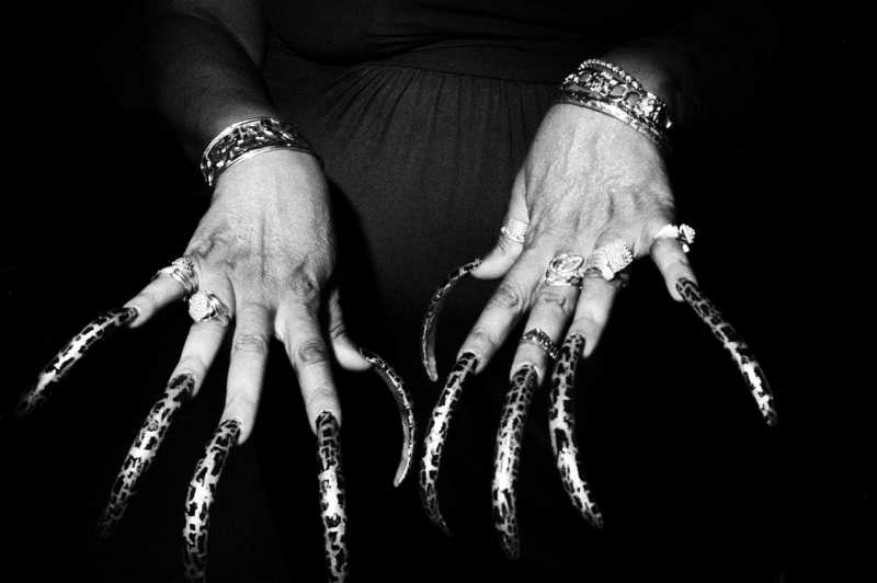 Showing the detail of her fingernails is more interesting than showing the entire body and face of the woman. It allows the viewer to wonder: Who is she? What is her life story?