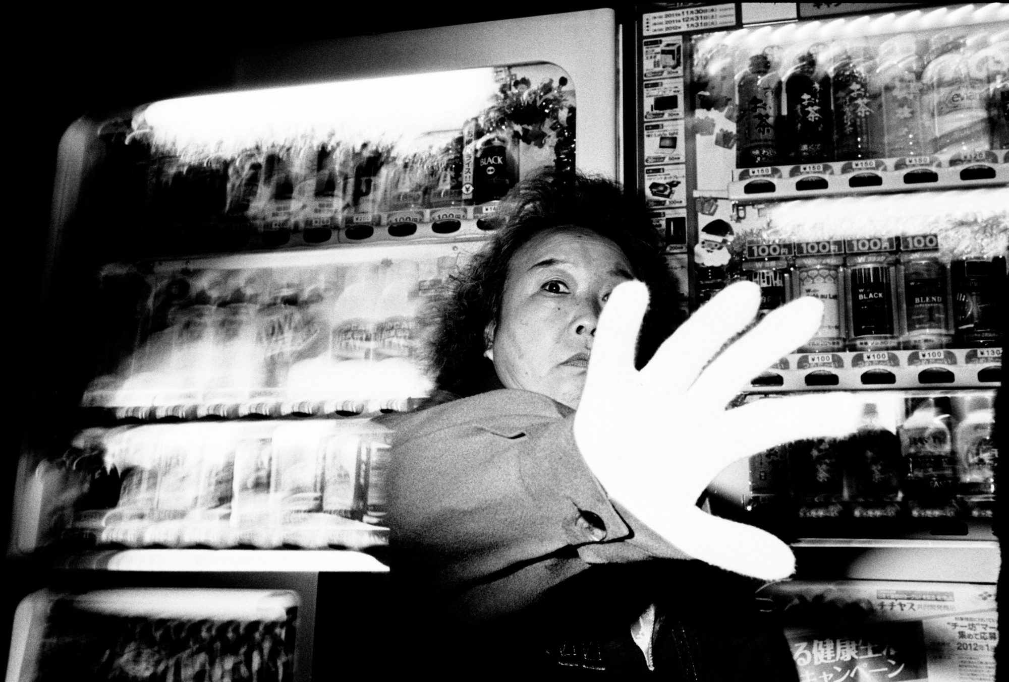 Tokyo, 2011. Woman with hand.