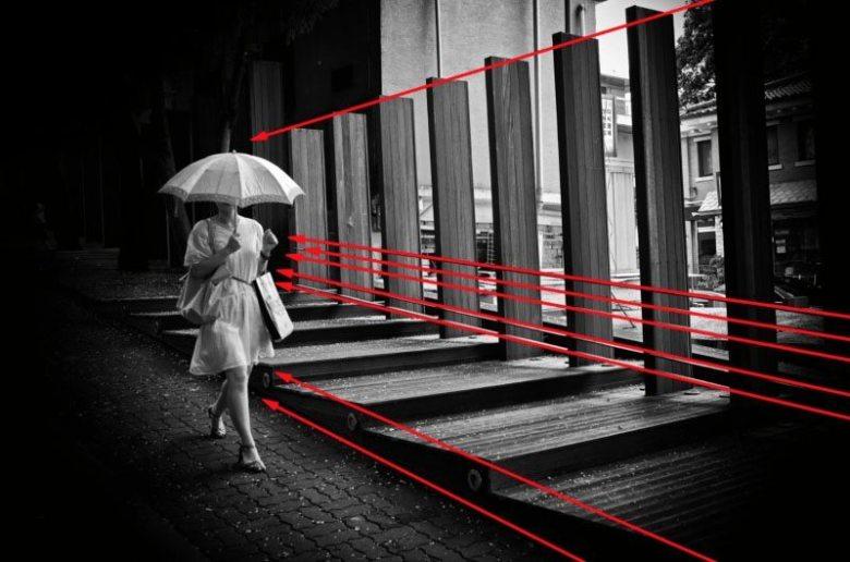 eric-kim-street-photography-leading-lines-composition-umbrella-seoul-2009-black-and-white