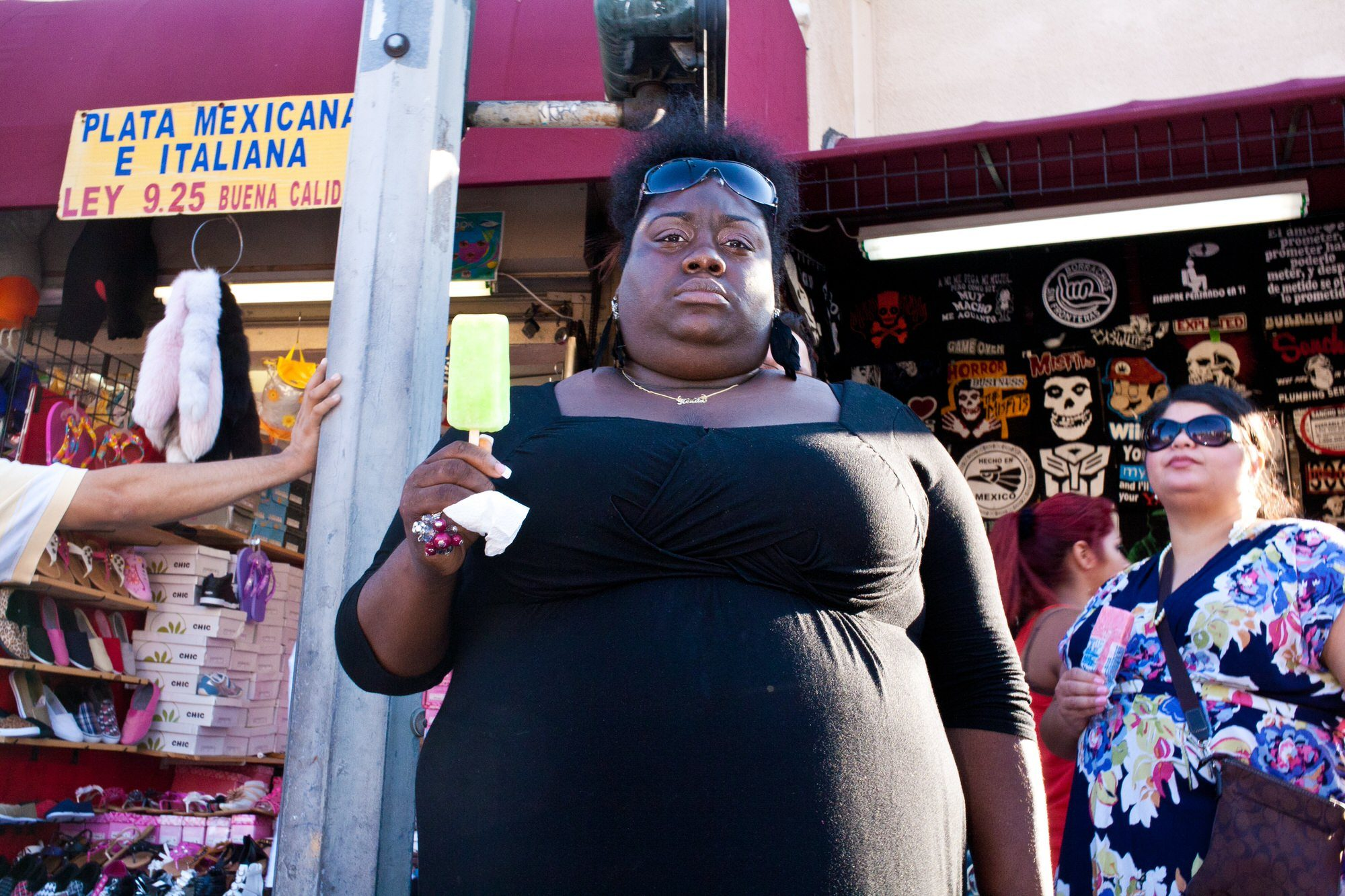 Downtown LA, 2011. Shot on a Canon 5D, 35mm f/2 lens. black woman with popsicle